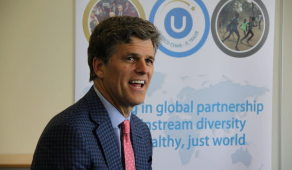 Tim Shriver smiles